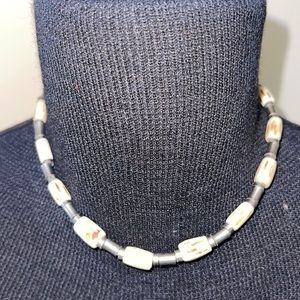 Metal and ivory like bead necklace